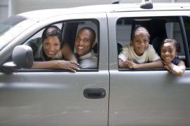 Family in Their SUV --- Image by © Royalty-Free/Corbis